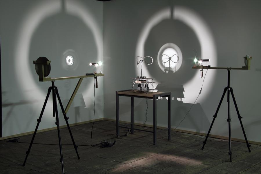 Clock Work, metal, wood, light projections, engine, variable dimension, 2011. Exhibition view at Galerija Gregor Podnar, Berlin, 2013. Photo: Marcus Schneider