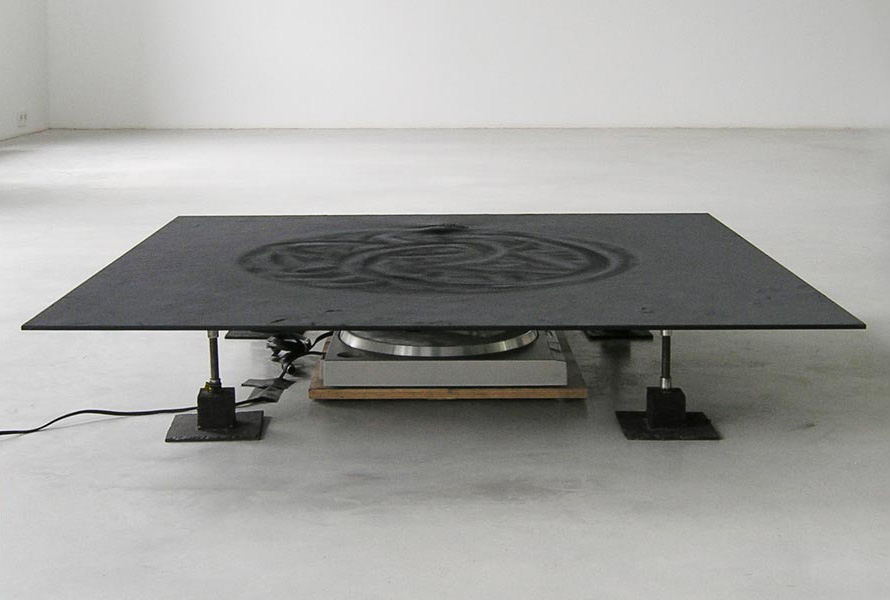 Drawing Machine, magnets, record player, glass plate, metal powder, 100 x 100 x 20 cm, 1992