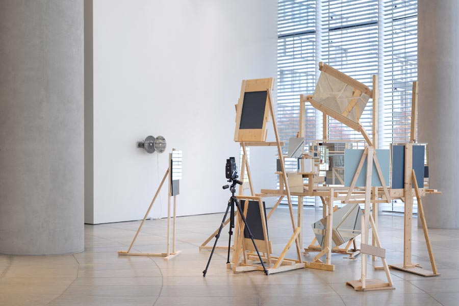 Photo Labyrinth, wooden construction, glass pane, one camera, mirrors, 500 x 500 x 500 cm, 2007. Exhibition view at Museum Folkwang im RWE Turm, Essen, 2008