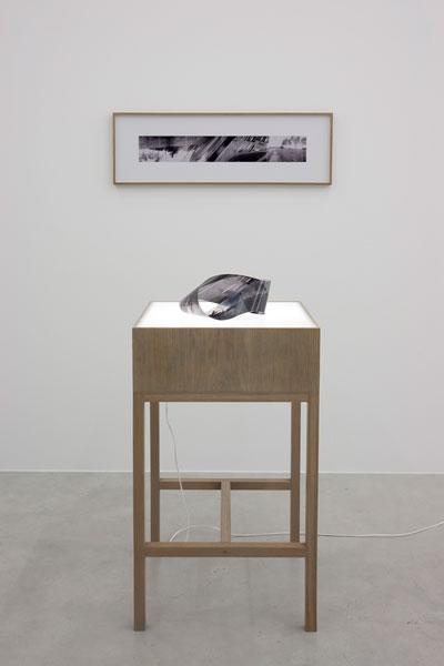 Möbius Space, looped transparency, ca. 25 x 15 x12 cm, flat photo stripe, B&W print, 70 x 11 cm (unframed size), light table, 2006. Exhibition view at Galerija Gregor Podnar, Berlin, 2009. Photo: Marcus Schneider
