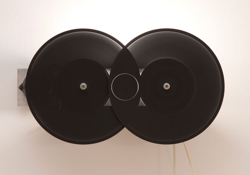 Occurrence Graph II (circle), lamp, aluminium, black paint, electric motor, spinning components, 67 x 35 x 23 cm, 1998