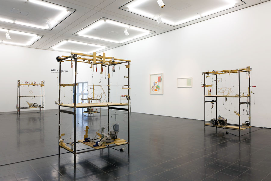 Platonic Constructions, wooden sticks, strings, pulley wheel, iron frame, electromotor, five different versions, 1997-2000. Exhibition view at Hamburger Kunsthalle - Galerie der Gegenwart, Hamburg, 2011