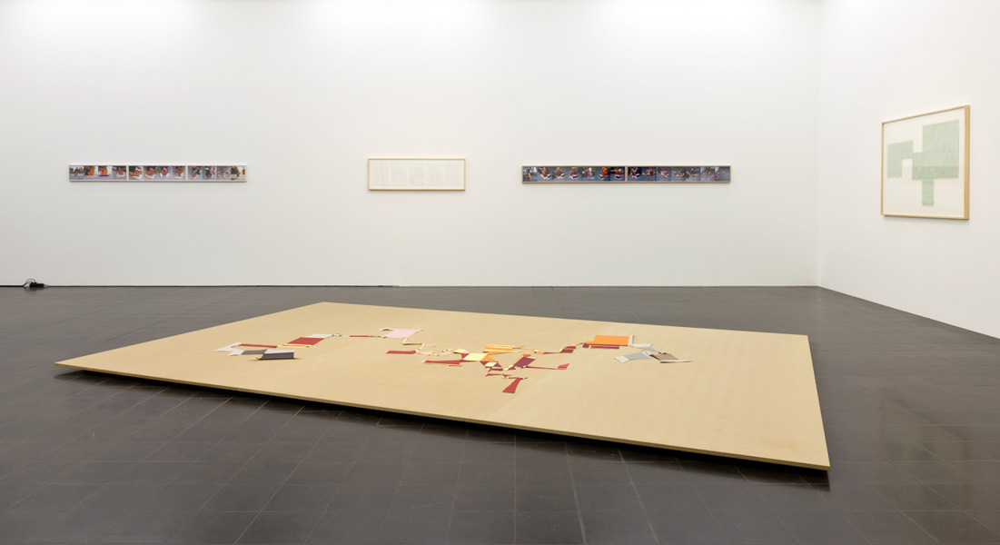 Peeled City II, cut paper (floor piece), drawing (pencil on millimeter paper), 5 sketches and a series of 15 C-prints, 2002. Exhibition view at Hamburger Kunsthalle - Galerie der Gegenwart, Hamburg, 2011
