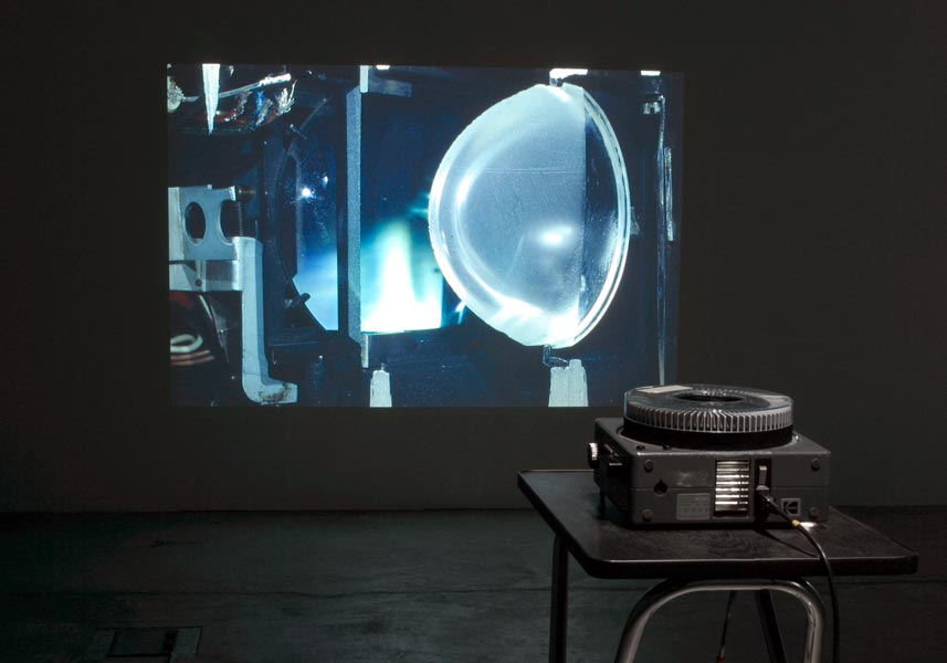 Exploded View, Kodak carousel slide projector, 81 slides, stand, timer, 55 mm lens, 2005. Exhibition view at Baltic Art Center, photo: Raymond Hejdström, 2005