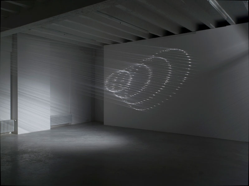 Re-Projection, nylon string, spotlight, variable dimensions, 2008