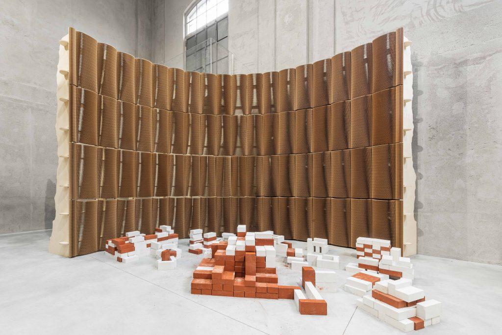 Brick Transfer Auditorium, 2017; plywood, paint, paper, metal, concrete bricks, variable dimensions. Installation view, Slight Agitation, Fondazione Prada, Milan. Photo: Delfino Sisto Legnani