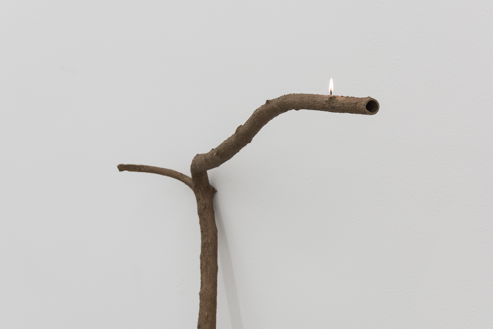 Ariel Schlesinger, At arm's length, 2017, bronze, cotton wick, lamp oil, variable dimensions